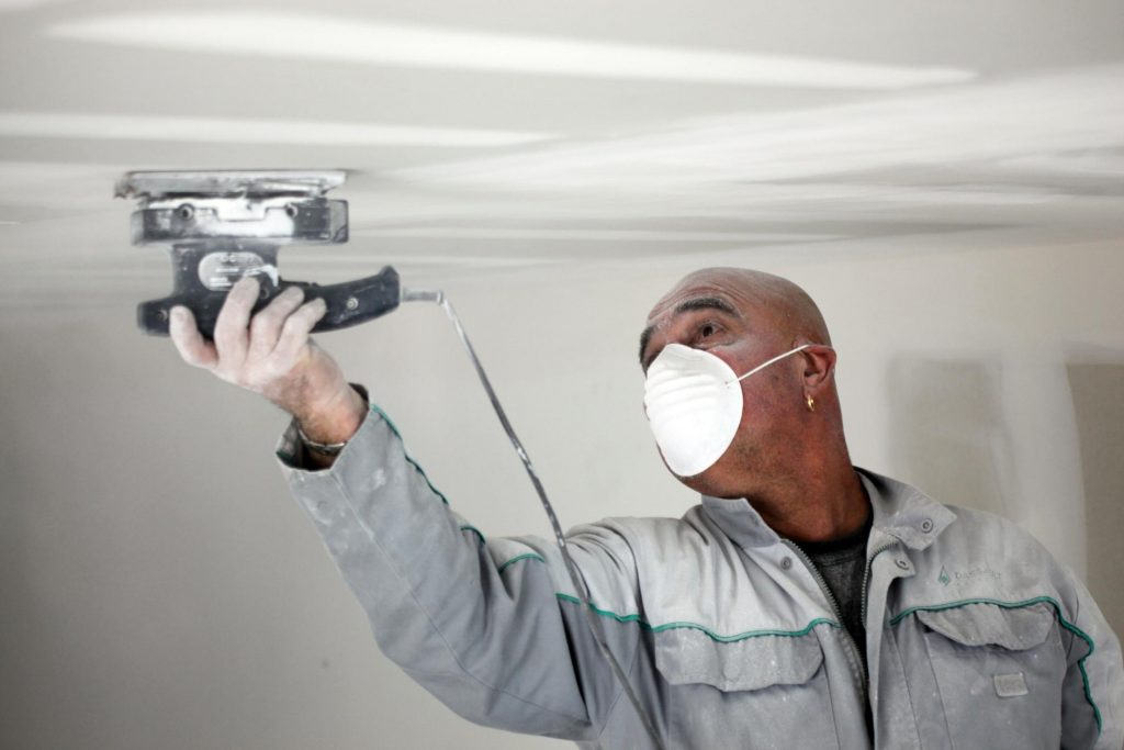 technician doing popcorn ceiling removal
