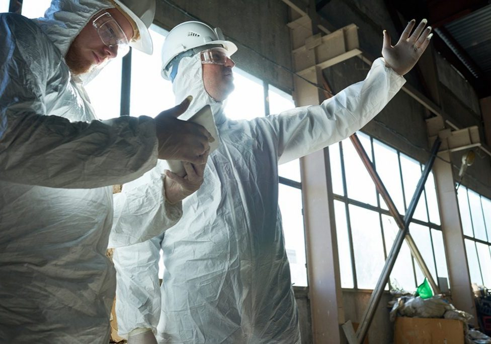technicians discussing about asbestos removal